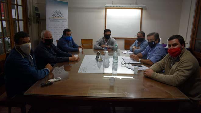 Miguel Feris acompaña al ministro de ganadería en diferentes reuniones.